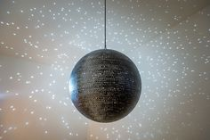 Katie Paterson, Totality, 2016 Totality is a mirrorball made with images of nearly every solar eclipse documented by humankind. Totaling over 10,000 unique images, these eclipses come together to reflect the progression of an eclipse across the room – from total through to quarter and half eclipses – mirroring the sequence of the Sun eclipsed by the Moon.