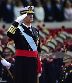 King Felipe VI of Spain salutes the Spanish National Day military parade in Madrid on October 12, 2015.