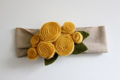Delia Creates has lots of ideas and instructions for soft knit headbands with various felt clip on embellishments--great for babies or older girls, too!