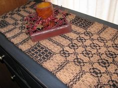 """I love our Primitive Black and Mustard Woven Coverlet Table Runner 56""""! Add a primitive centerpiece to your dining room table for a perfect primitive touch or use in a cabinet or on a shelf. https://www.primitivestarquiltshop.com/products/primitive-black-and-tan-woven-coverlet-table-runner-56 #primitivecountrykitchensanddiningrooms"""