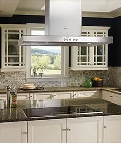 "Thermador transitional kitchen featuring a 36"" electric cooktop and a 48"" island vent hood"