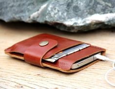 Mini brance brown leather iphone wallet case. $26.00, via Etsy.