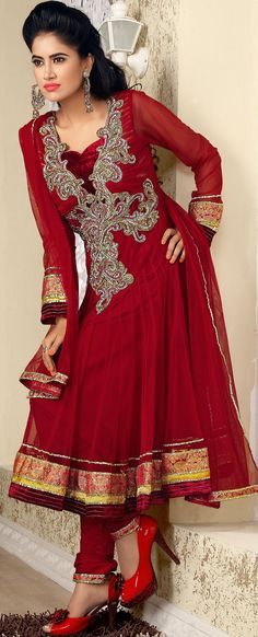 This season dazzle and shine in pure colors.   The dazzling dark red net churidar suit have amazing embroidery patch bordered work is done with cutdana, stones, bugle beads and antique zardosi work.   Beautiful embroidery work on kameez is stunning.   The entire ensemble makes an excellent wear.   Matching churidar and dupatta is available with this suit.   Slight Color variations are possible due to differing screen and photograph resolutions.