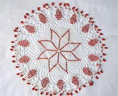 white crochet doily with raspberry red sead beads. €28.00, via Etsy.