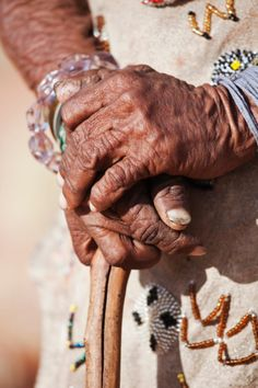 Indigenous Bushman/San elderly woman close up on hands, Namibia (Image taken to raise awareness and funds for the conservation projects of N/a''an ku sê Organisation; the bushmen having very close histor