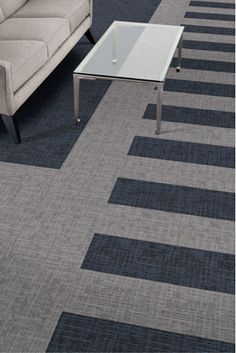 A new dimension to the way floors are designed: Plank and skinny plank modular carpet tiles are now available ready to be just the shape you need. Featured here: Nordic Stories. #design #floorcovering #plank #carpet #carpetdesign #moderndesign #designinmind