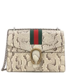 Gucci - Dionysus Medium snakeskin shoulder bag - Crafted from exotic python leather, this shoulder bag from Gucci will quickly become a staple in your wardrobe. Luxe status is locked in by the double tiger head decoration and the chain strap in silver-tone metal. Carry it in your hand from the office to dinner dates. seen @ www.mytheresa.com