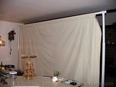 In The following article, Brian will demonstrate how to build a DIY backdrop stand. The stand, along with matching backdrop will help to create a controlled environment, with good subject/background separation. The cost is very low, just some PVC pipes, muslin and two really good hands. Oh, and a wife to agree to place this in the leaving room.
