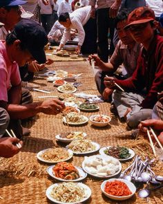 A feast of kimchi and other Korean dishes is laid out on straw mats to celebrate the launch of a fishing boat in Busan Korea. Photo from my book #VanishingAsia #Korea #Busan