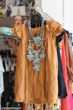 Cute top; fun necklaces.
