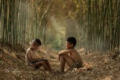 Asian two boys playing laptop at Countryside. - Asian two boys playing laptop at Countryside,Finding Notebook Computer Knowledge in Rural Asia.