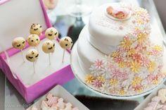Christening cake for little girl. And baby cake pops.
