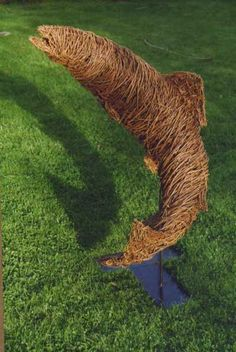 Willow or wire on a wire frame Willow sculpture by artist Julieann Worrall Hood titled: 'Leaping Trout' #sculpture #art