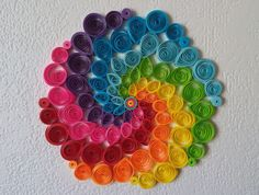 Object of decoration to hang (with a nylon thread) on a desk, wall, mirror, window, etc. Decoration size: diameter 100 to 120 mm Paper quilling 3 mm in assorted colors.