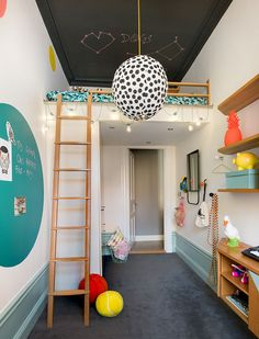 pops of color, a chalk ceiling, and a lofted bed in a kids room