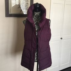 NWT Eileen Fisher High Collar Puffer Vest In a Raisin color. Quilted puffer vest with funnel collar, concealed zip front with snap closure. Angled welt pockets. Purchased from Saks. This vest is a size Small and was a little big on me as Eileen Fisher tends to run. Brand new from a smoke free home. Eileen Fisher Jackets & Coats Vests