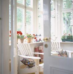 sunporch: white adirondack chairs we already have, plus idea of shelves around...