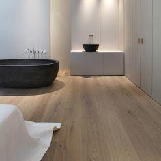 Black Tub + white wood flooring. House De by LensAss architecten , via Behance