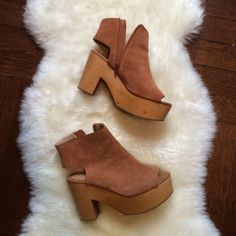"""Kelsi Dagger Suede peep toe ankle platforms Warm brown suede ankle booties with peep toe and open heel. Light wood platform heel. Very light weight and comfortable. Heel is about 3.5"""" high and front platform is about 1.5"""".  Zipper inside ankle. Only worn a few times, suede and wood in brand new condition, very slight wear on bottom of heels. Kelsi Dagger Shoes Mules & Clogs"""