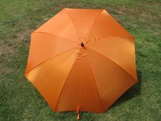 """Orange solid color 68"""" Golf Umbrella by Umbrella Store. Save 23 Off!. $15.49. Enjoy the outdoors with the Orange 68"""" golf umbrella. Perfect for the outdoor person. Covers 3 adults. Heavy duty construction for longlife. Manual open umbrella with steel shaft and black powder coat for rust protection. Gust return feature allows user to return umbrella to original form if inverted by the wind. 68"""" umbrella Arc measured across the top from point to point."""