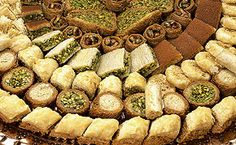 Arabic sweets including Baklawa (similar to Baklava but better; less sweet uses … Arabic sweets including Baklawa (similar to Baklava but better; less sweet uses Pistachios instead). Arabic Dessert, Arabic Sweets, Arabic Food, Arabic Names, Baklava Recipe, Lebanese Desserts, Lebanese Recipes, Middle Eastern Sweets, Sweets