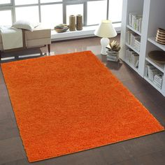 This beautiful modern shaggy orange area rug will definitely add a lot of brightness to your home. Include this beautiful rug for clean bold interior look . Shaggy Rug, Orange Area Rug, Round Rugs, Living Room Carpet, Bold Colors, Rug Size, Area Rugs, House Design, Interior