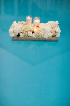 Romantic floating pool decor-GREAT for an outside rehearsal dinner or wedding reception!