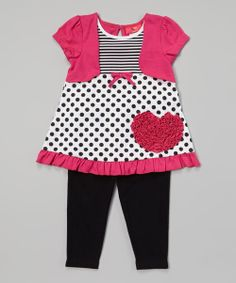 Picture perfect, this fun set treats little ones to a classic look that's filled with color. Ruffled accents and a faux bolero combine with a convenient closure on the tunic and an elastic waistband on the leggings, for a unique ensemble that's ready in no time at all.