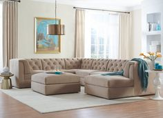 Sectional style tip: When building a room around a sectional, use accents sparingly to maintain a feeling of lightness in the space.