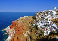 With its white villages atop lava rock cliffs and blue-domed churches overlooking a sunken caldera, Santorini feels a thousand miles from modern civilization.