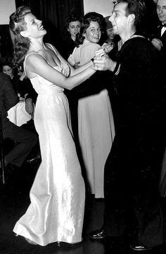 Rita Hayworth dancing with a sailor. www.girlinthejitterbugdress.com.