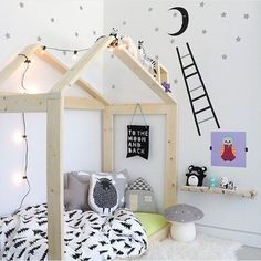 Nordic style kids room with whimsical, house-frame bed.