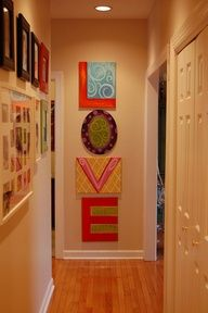 Photo by Lisa Frost on Flickr: lisA fRosT studio. One letter per canvas to fill a wall. Love!
