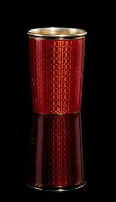 A silver-gilt and enamel beaker, Fabergé, Antti Nevalainen, St. Peterburg, 1898-1903, tapering form, decorated in translucent deep red enamel over engine turning.