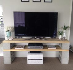 Diy cinder block tv cabinet put wheels under basket as for Block tv stand