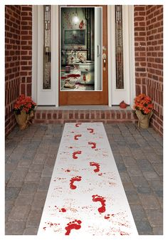 "Blood Footprints Runner    I think it would be creepier if it weren't a runner.  Cut the footprints out and double-sided tape them down going either in or out of the house.  Some ""bloody smears on and around the door would add to the creepy."