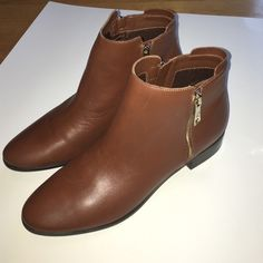 Marc Fisher leather booties Brown leather ankle boots. Never been worn, only tried on. No box/tags. Gold zippers (faux) on outside of boot and brown working zippers on inside. Marc Fisher Shoes Ankle Boots & Booties