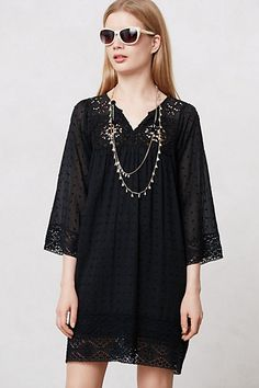 It's black and love the detailing and style ... great as a little breezy summer dress or as a tunic