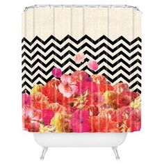 """Chevron-print shower curtain with a floral motif by artist Bianca Green for DENY Designs. Made in the USA.  Product: Shower curtainConstruction Material: PolyesterColor: MultiFeatures: Designed by Bianca Green for DENY DesignsDimensions: 69"""" H x 72"""" WNote: Shower rings not included"""