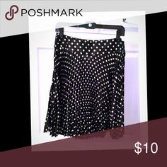 Polka Dot Skirt NWOT black and white with small pleats around entire skirt. Polyester. Comes right above my knee and Im 5'6. Skirts Midi