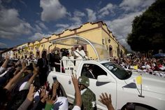 Pope Francis waves from his popemobile as he leaves the Cathedral in San Cristobal de las Casas, Mexico, Monday, Feb. 15, 2016. Francis celebrated Mexico's Indians on Monday with a visit to Chiapas state, a center of indigenous culture, where he presided over a Mass in three native languages thanks to a new Vatican decree approving their use in liturgy.