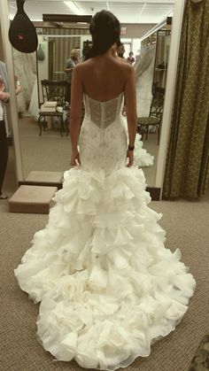 Maggie Sottero mermaid wedding dress with crystals see through detailed back and ruffles