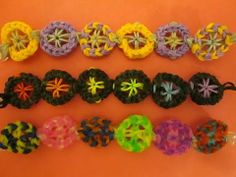 Rainbow Loom WHEEL Bracelet. Designed and loomed by Lovely Lovebird Designs. click photo for YouTube tutorial. 06/11/14.