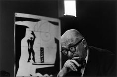 "Happy birthday to modern architecture great Le Corbusier. PARIS—Painter, architect, and city planner Le Corbusier in his studio at 35 rue de Sèvres, On the left: a lithograph of his measuring system known as the ""Modulor. Le Corbusier, Magnum Photos, Photo A Day, First Photo, Rue De Sevres, Photographer Portfolio, Photography Contests, Vintage Prints, Paris France"