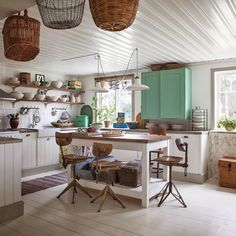 I like the large moulding on the bottom of the cabinets. The open shelves with the rustic wood.