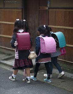 Japanese primary school children with their characteristic rucksacks - randoseeru.