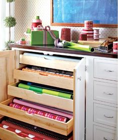 Use an old dresser for gift wrap. Dedicate one drawer to rolls of gift wrap; one to tissue paper and packing materials, like bubble wrap; and one to gifts to save. Small drawers can hold ribbon, twine, bows, gift cards, tape, and scissors.