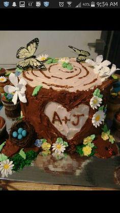 Tree stump cake with sugar flowers.