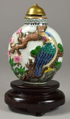 A stunning qing painted porcelain snuff bottle, with gilt cap