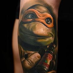 The great Nikko Hurtado tattooed this portrait of known party lover Michelangelo. #InkedMagazine #realism #NinjaTurtle #Michelangelo #tattoo #tattoos #inked #ink